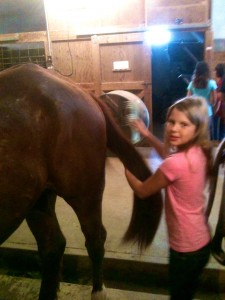Erin learning to care for horses at the Dude ranch